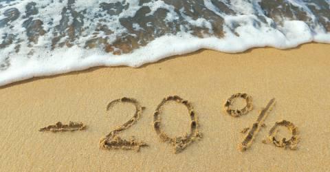 20 procent korting geschreven op het strand